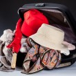 Suitcase and red umbrella — Stock fotografie