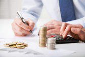 Accountants calculating profit — Stockfoto