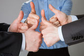 Successful business team showing thumbs up — Stock Photo