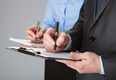 Closeup of working business team taking notes — Stok fotoğraf