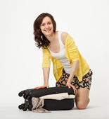Attractive woman packing her suitcase — Stock Photo