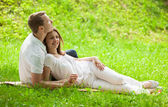 Loving couple having time together in a green meadow — Stock Photo