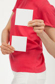 Woman's hands holding two blank white stickers — Stockfoto