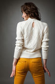 Slender young woman turning back — Stock Photo