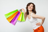 Woman holding multicolored shopping bags — Stock Photo