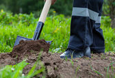 Digging spring soil with shovel. — Stock Photo