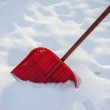 Red shovel for snow removal — Stock Photo #51211781