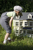 Boy and house for dolls — Stock Photo