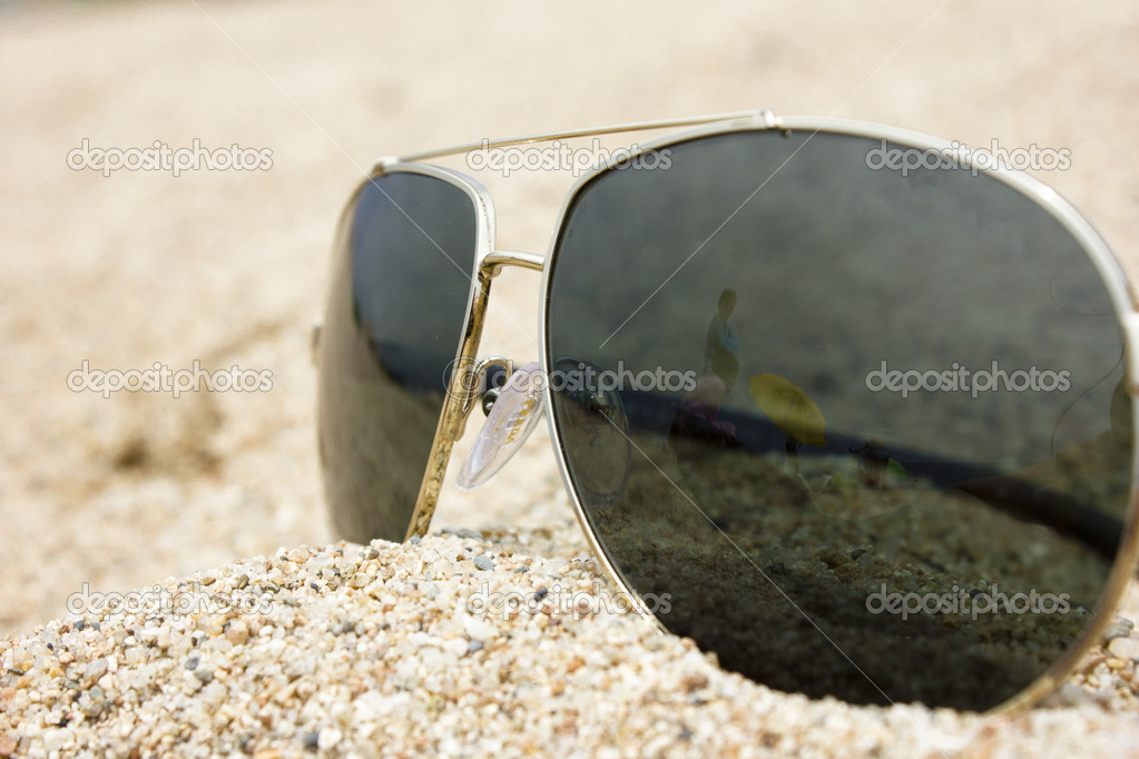 Sunglasses On Sand  sunglasses in the sand at the beach stock photo gabylya89