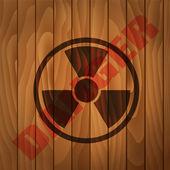 Stamp Danger label wooden background — Stock Vector