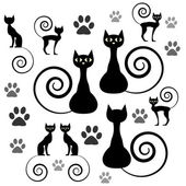 A set of black cat silhouettes — Stock Vector