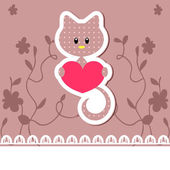 Kitten holding heart — Stock Vector