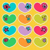 Un ensemble de coeurs assez coloré — Vecteur