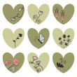Set of hearts decorated with flowers — Stock Vector