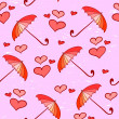 Pink feminine seamless pattern with umbrellas and hearts — Stock Vector