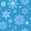 Seamless winter background with snowflakes — Stock Vector