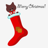Kerstkaart met kleine kitten in de sok — Stockvector