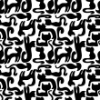 Seamless pattern with black cats silhouettes — Grafika wektorowa