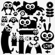 Stock Vector: Black silhouettes of cute animals. Stickers design