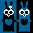 Couple of cute bunnies in love — Stock Vector