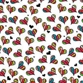 Cute seamless pattern with colorful hearts — Stock Vector