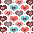 Stock Vector: Seamless pattern with cute hearts