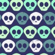 Seamless pattern with human skulls - Stockvectorbeeld