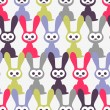 Seamless pattern with funny rabbits - Stock Vector