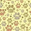 Seamless pattern with animal paws — Stock Vector