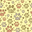 Stock Vector: Seamless pattern with animal paws