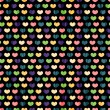 Stock Vector: Seamless pattern with colorful hearts