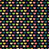Seamless pattern with colorful hearts — Stock Vector