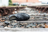 Abandoned shoe on train tracks — Stock Photo