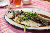 Steamed fish in black bean and soy sauce at Hong Kong restaurant — Stock Photo