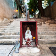 Hong Kong street shrine containing statue of Guanyin — Stock Photo #40516289