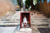 Hong Kong street shrine containing statue of Guanyin — Stock Photo