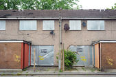 Abandoned terraced housing with metal shutters, Salford, UK — Stock Photo