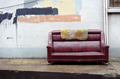 Old abandoned couch dumped on the street — Stock Photo