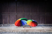 Rainbow umbrellas in the old town of Suzhou, China — Stock Photo