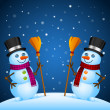 Two snowmen stand with broom — Stock Vector #35006445