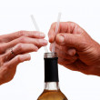 Wine bottle with hands holding two straws. — Stock fotografie