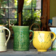 Four old ceramic pitchers - Stock Photo