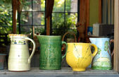 Four old ceramic pitchers — Stock Photo