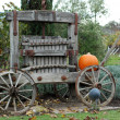 Pumpkin on top of old wood cart — Stock Photo