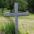 Single wood cross in a cemetery - Stock Photo