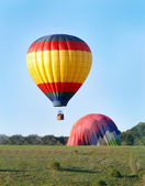 Hot Air Balloons landing — Stock Photo