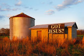 Sign on farm building: Got Jesus — Stok fotoğraf