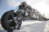 Giant cable excavator nordic worksite winter big enormous sunset machinery equipment — Stock Photo