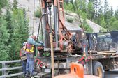 Geotechnical drilling rig road investigation driller labour worker drill — Stock Photo