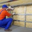 图库照片: Thermal insulation work